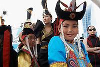 Mongolie, Oulan Bator, Place Sukhbaatar, concours du plus beau costume pour la fete du Naadam. // Mongolia, Ulan Bator, Sukhbaatar square, costume parade for the Naadam festival