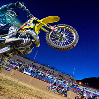 101312       Cable Hoover<br /> <br /> Pro rider Aaron Barber competes in the wheelie contest during the Animosity freestyle moto-x tournament at Red Rock Park in Gallup Saturday.