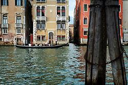 Couple on a balcony, Grand Canal, Accademia, Venice, Italy.<br /> Photo: Ed Maynard<br /> 07976 239803<br /> www.edmaynard.com