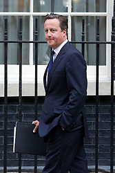 "© Licensed to London News Pictures. 29/08/2013. London, UK. David Cameron, the British Prime Minister, looks tense as he leaves a meeting of the his cabinet on Downing Street in London today (29/08/2013) as he heads for a recalled British Parliament preparing to debate the possibility of ""direct"" military action over recent reports an alleged chemical weapons attack in Syria. Photo credit: Matt Cetti-Roberts/LNP"