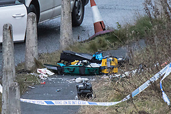 © Licensed to London News Pictures. 03/01/2017. Huddersfield, UK. Used medical equipment at the scene of a bullet riddled white Audi car at the slip road at Junction 24 of the M62 motorway in Huddersfield . West Yorkshire police have announced a man has died following the discharge of a police firearm , during what they describe as a pre-planned operation , yesterday evening (2nd January 2017) . Photo credit : Joel Goodman/LNP