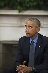 October 7, 2016 - Washington, District of Columbia, United States of America - United States President Barack Obama responds to questions from reporters while meeting with U.S. Federal Emergency Management Agency Administrator Craig Fugate, U.S. Secretary of Homeland Security Jeh Johnson and Deputy Homeland Security Advisor Amy Pope in the Oval Office of the White House in Washington, D.C., U.S., on Friday, October 7, 2016. .Credit: Rod Lamkey Jr. / Pool via CNP (Credit Image: © Rod Lamkey Jr/CNP via ZUMA Wire)