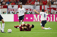 Photo: Chris Ratcliffe.<br /> England v Portugal. Quarter Finals, FIFA World Cup 2006. 01/07/2006.<br /> Cristiano Ronaldo of Portugal rolls around in agony after an innocuous challenge from Frank Lampard, Ashley Cole watching on.