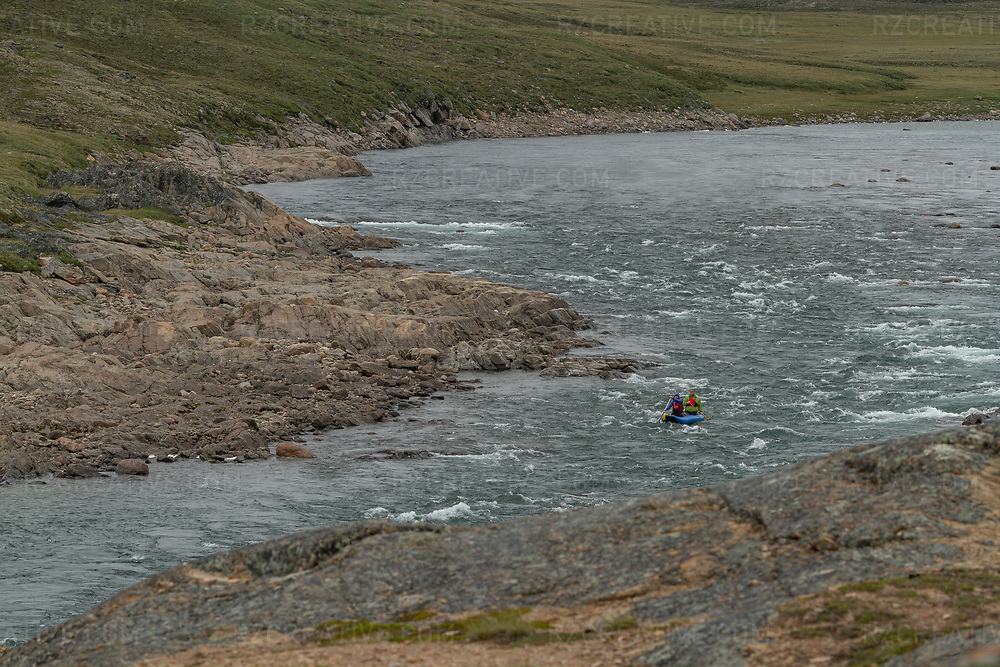 Two paddlers in an inflatable kayak paddle on the Sylvia Grinnell River in Iqaluit, NU, Canada. Photo © Robert Zaleski / rzcreative.com<br /> —<br /> To license this image for editorial or commercial use, please contact Robert@rzcreative.com