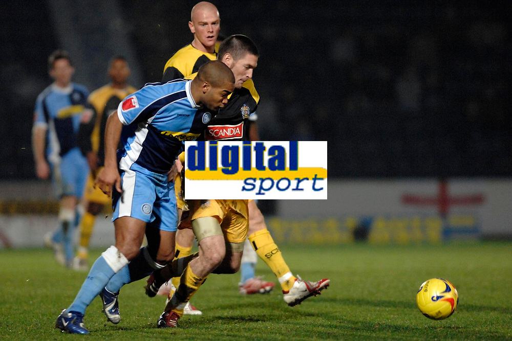 Photo: Richard Lane.<br />Wycombe Wanderers v Stockport County. Coca Cola League 2. 23/12/2006. <br />Wycombe's Kevin Betsy breaks past Stockport's Gareth Owen.