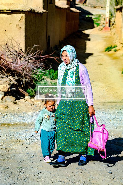 A woman taking her child to nursery in Tamtetoucht, Morocco<br /> <br /> (c) Andrew Wilson | Edinburgh Elite media