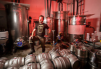 Head brewer Josiah Blomquist with some casks at MacLeod Ale brewing co in Van Nuys, CA.  November 6, 2015. Photo by David Sprague