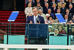 United States President George H.W. Bush delivers his Inaugural Address after being sworn-in as 41st President of the United States at the US Capitol on January 20, 1989. Former US President Ronald Reagan and former first lady Nancy Reagan look on from the right. Photo by Louis Jacobson / CNP /ABACAPRESS.COM