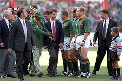 South Africa President Nelson Mandela, third left, is introduced to the South African rugby union team, including captain Francois Pienaar, third right, before the start of the rugby union World Cup final.