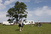 A young traveller tries out a new pony at the ancient annual Priddy Sheep (and horse) fair in Somerset, England. Set in the Mendip Hills, in the south-western English county of Somerset, the Priddy Sheep fair is host to an odd mix of farmers and travellers (commonly and incorrectly known as gypsies). In this field set aside purely for travellers, many with West Country accents but also with nearby Welsh and Irish too, deals are done with a traditional spit on the hand and a smacking of palms, selling a pony to another family. The Priddy Sheep Fair moved from the city of Wells in 1348 because of the Black Death.