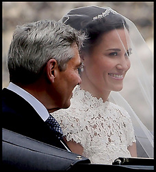 May 20, 2017 - London - Pippa Middleton wedding to James Matthews. The wedding of Pippa Middleton to James Matthews takes place at St.Mark's Church in Englefield, Berkshire, United Kingdom, Pippa Middleton arrives at St.Mark's Church with her father Michael. (Credit Image: © i-Images via ZUMA Press)