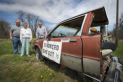 April 24, 2018 - Edgerton, KS, USA - The half-car placed along the road in Edgerton, Kan., by Ray Braun about 20 years has been a landmark in the Johnson County town. The half-car might have to be removed. Bill Braun, from left, and his mother, Jo Braun (Ray's wife and son) of Baldwin City, Kan., talked with current property owner Danny O'Neal (right) about the Edgerton landmark during a visit on April 24, 2018 to their former property. (Credit Image: © Tammy Ljungblad/TNS via ZUMA Wire)