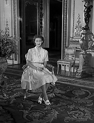 H.R.H. Princess Margaret, who is about to celebrate her seventeenth birthday on the 21st of August, poses informally in a summery silk polka-dotted dress and a double row of pearls.