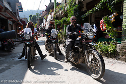 Led Sled's Pat Patterson leading Tattoo artist Justin Big Meas Wilson and Gary Thomas on their Royal Enfield Himalayans through a little village during Motorcycle Sherpa's Ride to the Heavens motorcycle adventure in the Himalayas of Nepal. On the third day of riding, we went from Pokhara to Kalopani. Wednesday, November 6, 2019. Photography ©2019 Michael Lichter.
