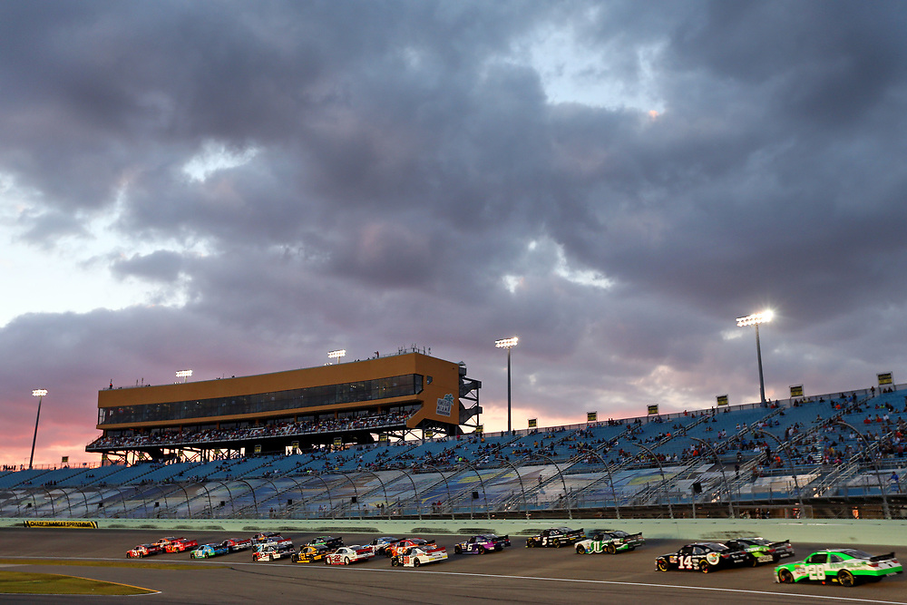 Nov 19, 2016; Homestead, FL, USA; The field goes into turn one during the Ford Ecoboost 300 at Homestead-Miami Speedway. Mandatory Credit: Peter Casey-USA TODAY Sports