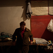 A local woman stands beside her belongings in a coal mine used as a bomb shelter outside Donetsk.