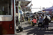 People enjoying the sun at a roadside café on South Congress in South Austin