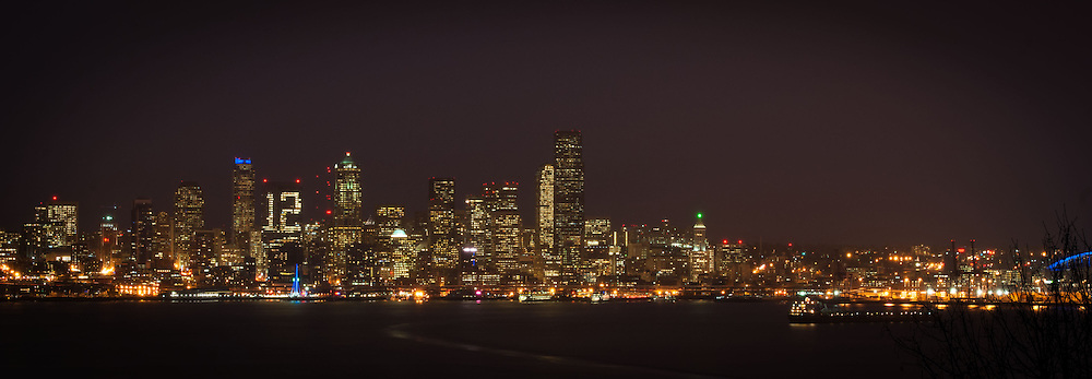 2014 January 10 - The skyline of downtown Seattle, WA. The Russell Investments Center building shows a 12 in its windows supporting the Seattle Seahawks football team. Seen from Hamilton Viewpoint in West Seattle. By Richard Walker