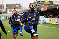 AFC Wimbledon midfielder Liam Trotter (14) warming up before the EFL Sky Bet League 1 match between AFC Wimbledon and Plymouth Argyle at the Cherry Red Records Stadium, Kingston, England on 26 December 2018.