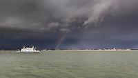 Wightlink ferry crossing the solent under stormy winter skies