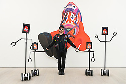 "© Licensed to London News Pictures. 29/10/2020. London, UK. Artist Phillip Colbert posing with interactive robots and painting titled Shark (2020) at the press preview of his exhibition ""Lobsteropolis"" showing at the Saatchi gallery. Photo credit: Ray Tang/LNP"