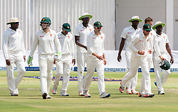 Zimbabwe players rally together after a wicket during the second day of the 100th test match for Zimbabwe played in a match with Sri Lanka at Harare Sports Club 30 October 2016.