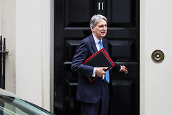 London, UK. 9th January, 2019. Philip Hammond MP, Chancellor of the Exchequer, leaves 10 Downing Street to attend the first session of Prime Minister's Questions since the Christmas recess, followed by the first day of the Brexit debate which will precede next week's vote in the House of Commons.