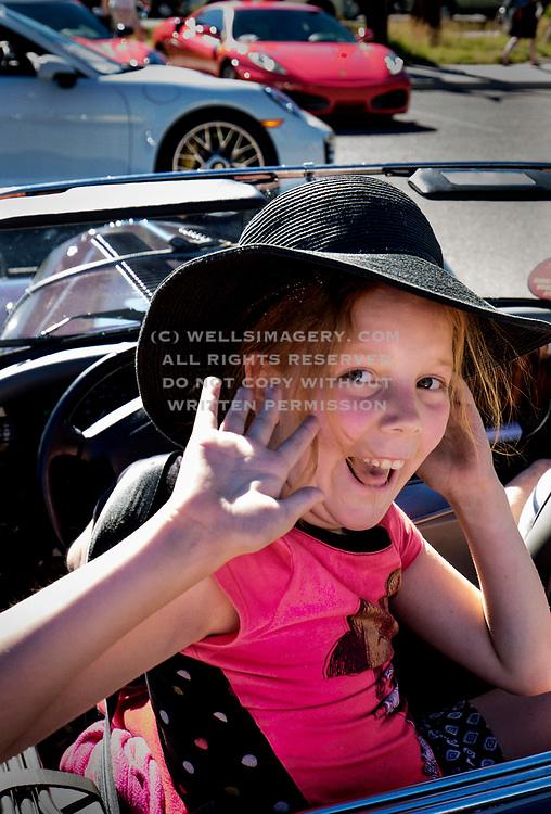Image of a young girl enjoying the Sun Valley Road Rally in Sun Valley, Idaho, Pacific Northwest by Randy Wells