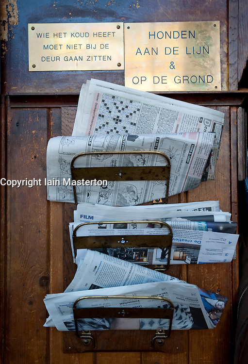 Detail of newspaper rack inside very old 17th Century Cafe Paneneiland on Prisengracht canal in Amsterdam Netherlands