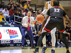Dec 14, 2019; Morgantown, WV, USA; Nicholls State Colonels head coach Austin Claunch claps from the bench during the second half against the West Virginia Mountaineers at WVU Coliseum. Mandatory Credit: Ben Queen-USA TODAY Sports