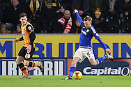 Craig Noone of Cardiff City  kicks forward past Hull City defender Andrew Robertson (26)  during the Sky Bet Championship match between Hull City and Cardiff City at the KC Stadium, Kingston upon Hull, England on 13 January 2016. Photo by Ian Lyall.