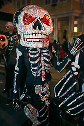 28 Feb 2014. New Orleans, Louisiana.<br /> Mardi Gras. The Skeleton Krewe as they prepare to walk the route for The Krewe D'Etat parade along Magazine Street through Uptown New orleans. <br /> Photo; Charlie Varley/varleypix.com