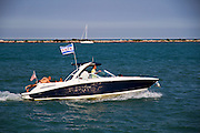 A motorboat flying an Illinois flag in the Chicago harbor Illinois, USA
