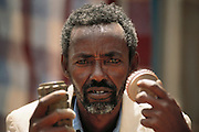 Abdillahi Behi Oday, head of Somali National Pioneer Corps with mine display at Rimfire headquarters? the British company which is coordinating and training the de-mining effort of the Pioneers. He is holding a Pakastani anti-personnel mine, which is the most common one found in the area. Hargeisa, Somaliland. Somaliland is the breakaway republic in northern Somalia that declared independence in 1991 after 50,000 died in civil war March 1992.
