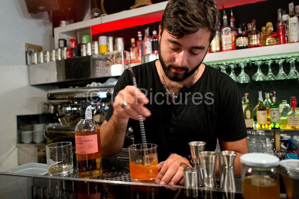 A man making a cocktail in a cocktail bar: Barnum / cocktail tours. Rome, Italy.