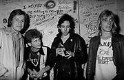 Rambo, Mick Jones and Mick Ronson backstage 1977