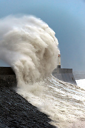 © Licensed to London News Pictures. 8/02/2016. Porthcawl, Bridgend, Wales, UK. Huge waves pound the harbour wall .Storm Imogen batters the small Welsh seaside resort of Porthcawl in the county borough of Bridgend on the South coast of Wales, UK. Photo credit: Graham M. Lawrence/LNP