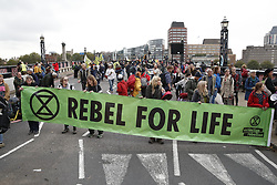 © Licensed to London News Pictures. 07/10/2019. London, UK. Extinction Rebellion protestors block Lambeth Bridge in central London . Activists will converge on Westminster blockading roads in the area for at least two weeks calling on government departments to 'Tell the Truth' about what they are doing to tackle the Emergency. Photo credit: Peter Macdiarmid/LNP