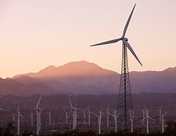 Turbines on a wind farm in Palm Springs, California at sunset.