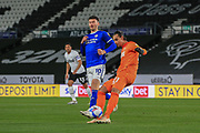 Kelle Roos of Derby County (21) clears the ball as Cardiff City forward Kieffer Moore (10) closes in during the EFL Sky Bet Championship match between Derby County and Cardiff City at the Pride Park, Derby, England on 28 October 2020.