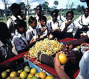 Titchfield School Children at Orange stall, Port Antonio - Jamaica