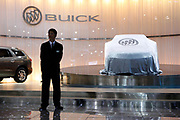 Exhibition staff stands in front of a Buick display at the Auto Shanghai 2009 in Shanghai, China, on Monday, April 20, 2009.  Automakers from across the world are increasingly focusing their efforts on China, the largest auto market in the world and the only major market with prospects of high growth rate.