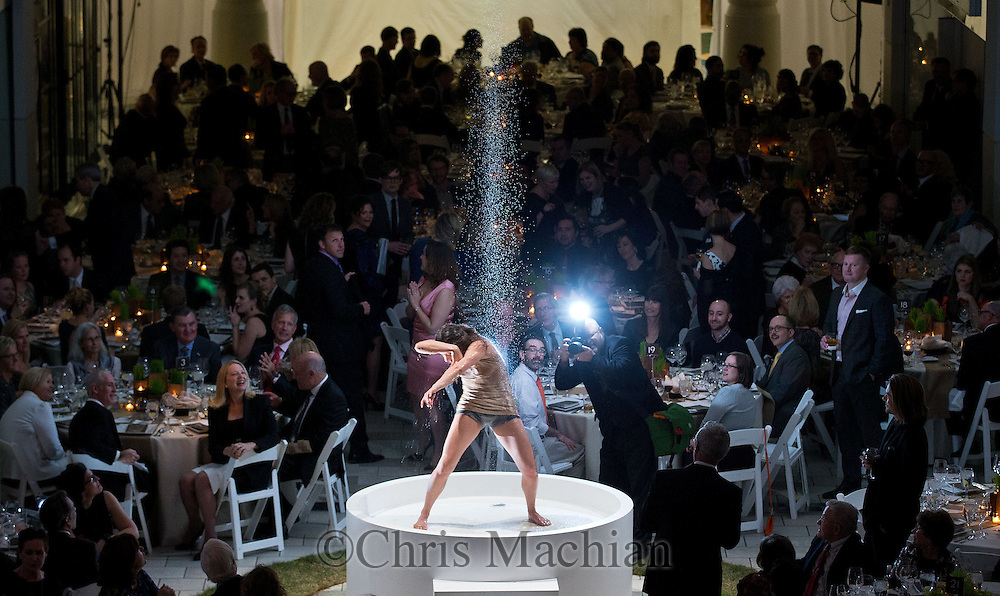 """Omaha, NEB <br /> <br /> A dancer performs under a stream of water during Opera Omaha's preview of John Adams's """"A Flowering Tree,"""" at the Crossroads Mall on Friday, January 16, 2015. <br /> <br /> CHRIS MACHIAN/THE WORLD-HERALD"""