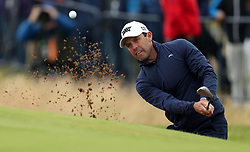South Africa's Charl Schwartzel chips in straight from the bunker on the first hole during day four of The Open Championship 2016 at Royal Troon Golf Club, South Ayrshire.
