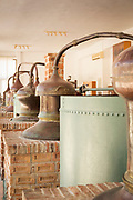 Old stills displayed in small museum above Barbayanni Distillery, Lesbos, Greece