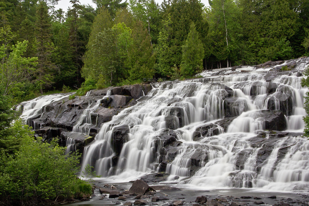 Bond Falls in Michigan's Upper peninsula. A beautiful set of falls located near Paulding, Michigan on the Middle Branch of the Ontonagon River . Image was taken in the spring 2012 while on a fishing trip to Lake Goegbic