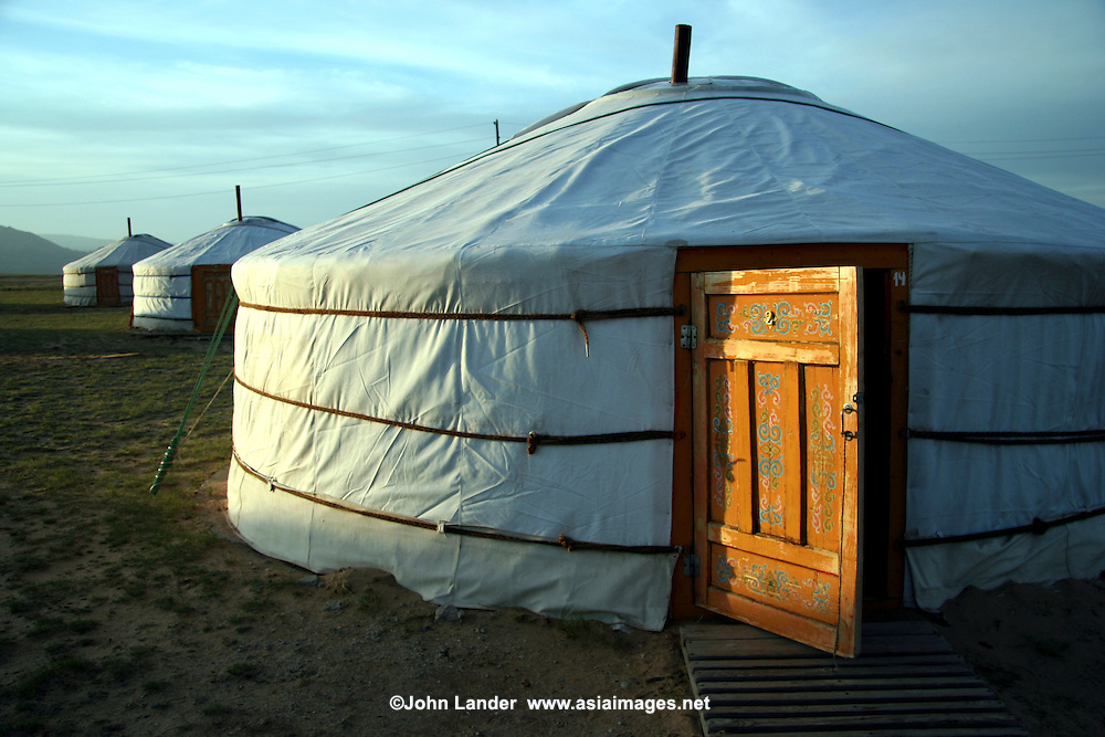 Traditional ger or yurts consist of a circular wooden frame carrying a felt cover. The felt is made from the wool of the flocks of sheep that accompany most nomads. The timber to make the external structure is not found on the treeless steppes so must be bought or traded for in the towns or village. The frame consists of lattice wall sections, a door frame, roof poles and a crown. Some ger have columns to support the crown. The frame is covered with pieces of felt which is then covered with canvas for waterproofing and windproofing.
