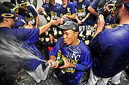 Oct 15, 2014; Kansas City, MO, USA; Kansas City Royals outfielder Terrance Gore (bottom) celebrates with teammates in the clubhouse after game four of the 2014 ALCS playoff baseball game against the Baltimore Orioles at Kauffman Stadium. The Royals swept the Orioles to advance to the World Series. Mandatory Credit: Peter G. Aiken-USA TODAY Sports