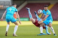 Cheltenham Town Sean Long (2) Scunthorpe United Kevin van Veen (10) battles for possession during the EFL Sky Bet League 2 match between Scunthorpe United and Cheltenham Town at the Sands Venue Stadium, Scunthorpe, England on 27 February 2021.