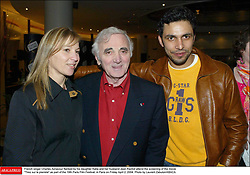 French singer Charles Aznavour flanked by his daughter Katia and her husband Jean Rachid attend the screening of the movie Tirez sur le pianiste as part of the 19th Paris Film Festival, in Paris on Friday April 2, 2004. Photo by Laurent Zabulon/ABACA.
